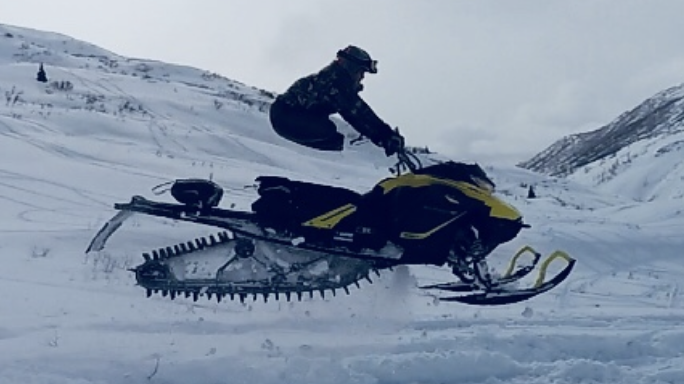 Double amputee and all Alaskan badass, Israel Hale, running his snow machine in the back country of Alaska